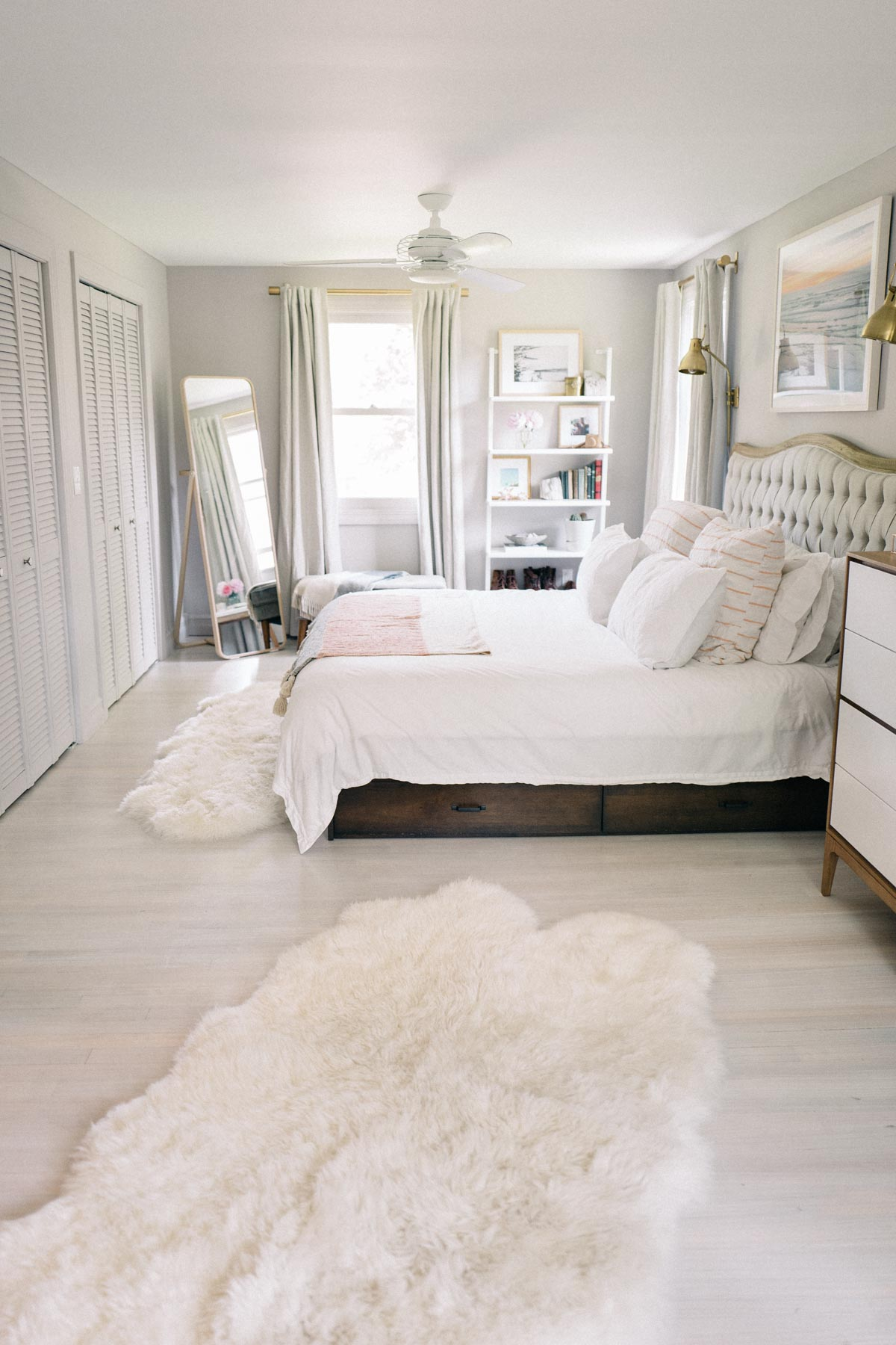 Jess Ann Kirby reveals her master bedroom renovations with faux fur throws and white washed floors