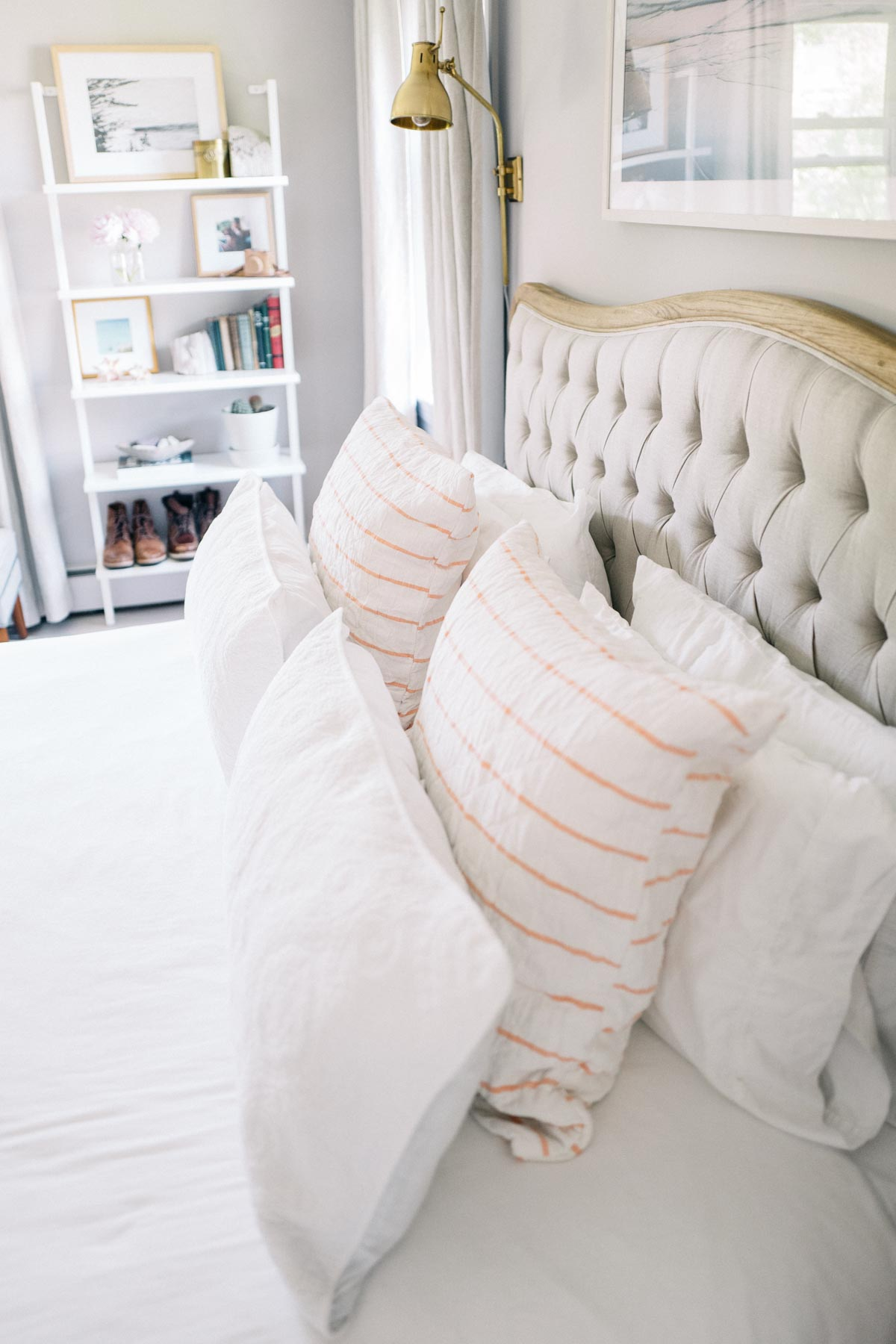 Jess Ann Kirby installed a tufted headboard and REbecca Atwood shams for her updated bed