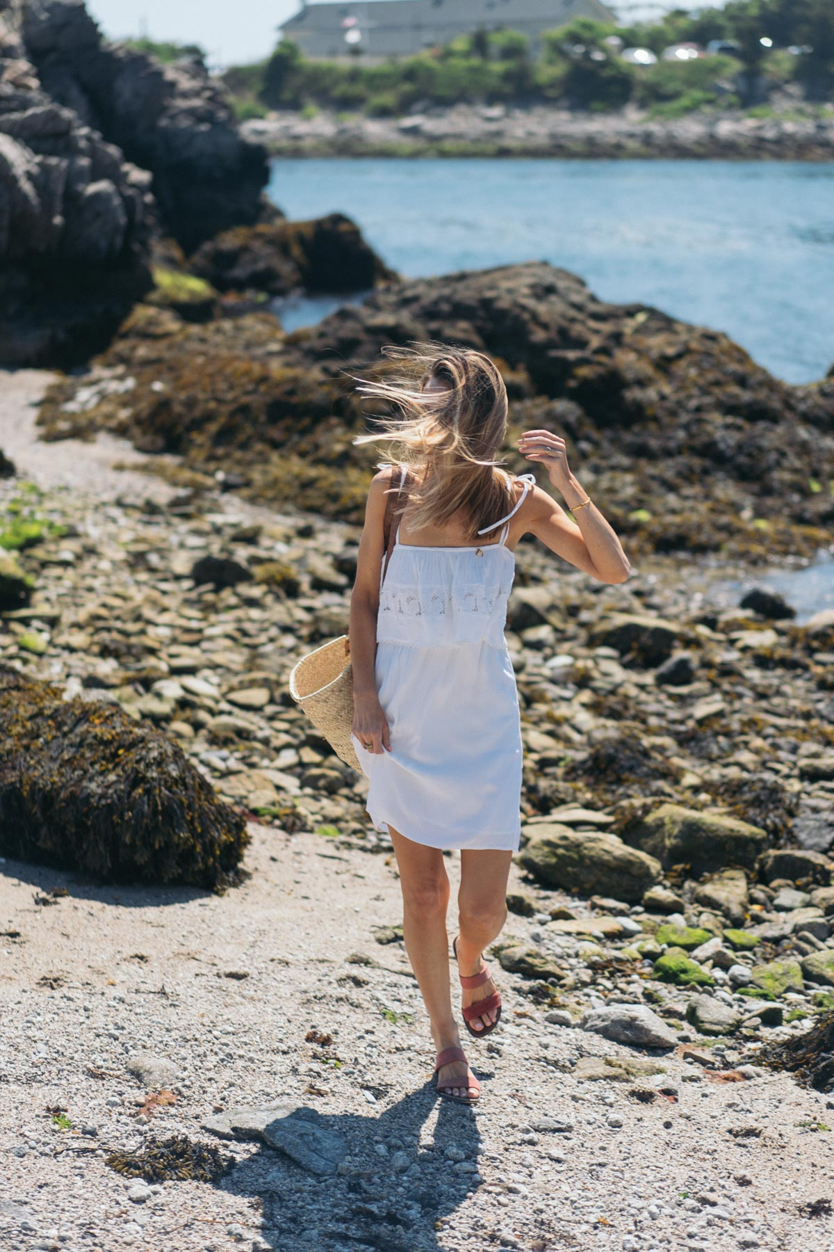 Jess Ann Kirby wears an LSpace Jaclyn dress with Sam Edelman Gala Sandals for a beach day in Newport